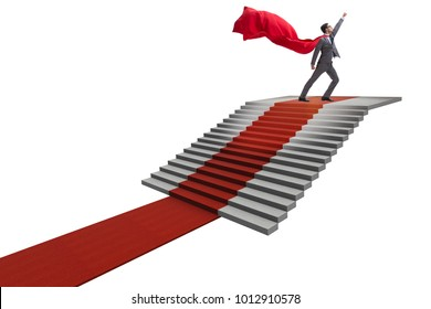 Superhero businessman climbing red carpet stairs