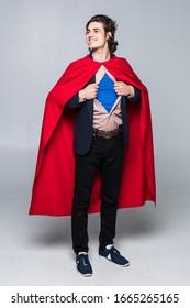 Superhero businessman isolated on gray background