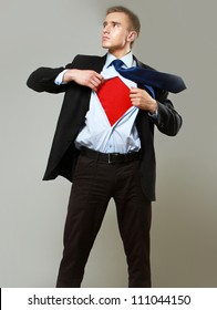 Superhero businessman, isolated on grey backgroound