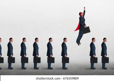 superhero businessman overcoming inertia flying away from a static queue of businessmen