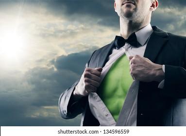 Superhero businessman pulls open shirt. Green Power