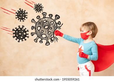 Superhero child beat drawing virus. Super hero kid against grunge wall. Coronavirus COVID-19 pandemic concept