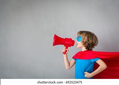 Superhero child. Kid pretend to be businessman. Success, creative and communication concept