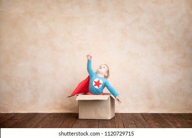 Superhero child. Super hero kid playing at home. Think outside the box concept