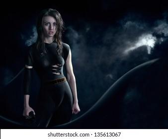 Superhero in dark suit and long cloak