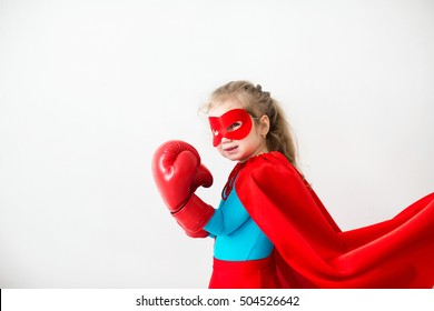 Superhero kid in boxing gloves Isolated on white background. Girl power and feminism concept.