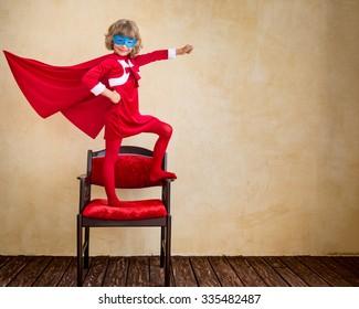 Superhero kid at home. Christmas holiday concept