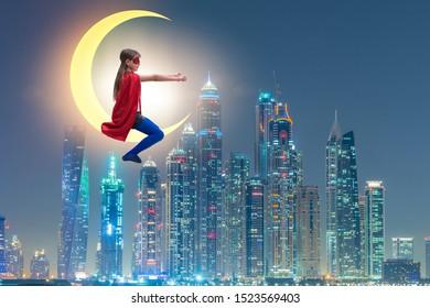 Superhero kid sitting on the moon crescent