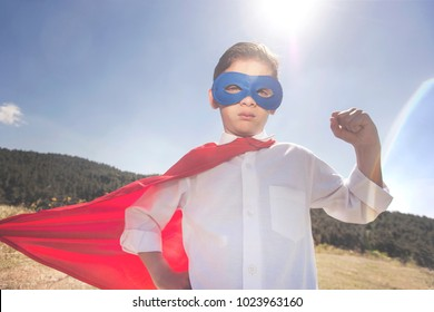 Superhero kid. Success concept. (Vintage filtered image with selective focus)