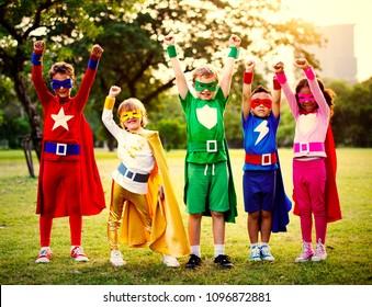 Superhero kids having fun and playing together
