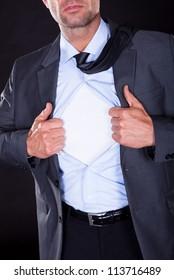 Superhero Tearing Off His Shirt On Black Background