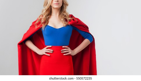 Superhero Woman. Young and beautiful blonde in image of superheroine. Close-up, place for text on the right