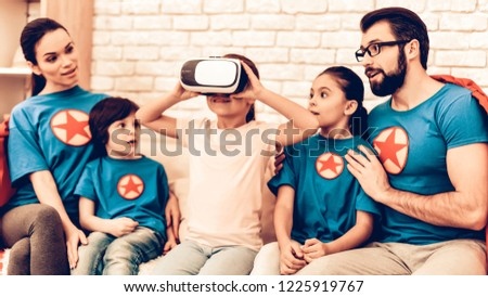 3d499ede3a52 Superheroes Family Looking Kid Playing VR Headset. Virtual Journey. Future  Technology Concept. Girl