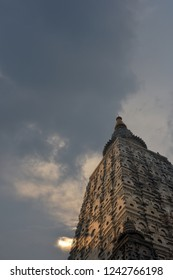 A superimposed or double exposures of the holiest site of Buddhism, Mahabodhi temple, bodh gaya, a UNESCOWorld Heritage Site, India, where Buddha attained enlightenment with mindfulness sunset clouds