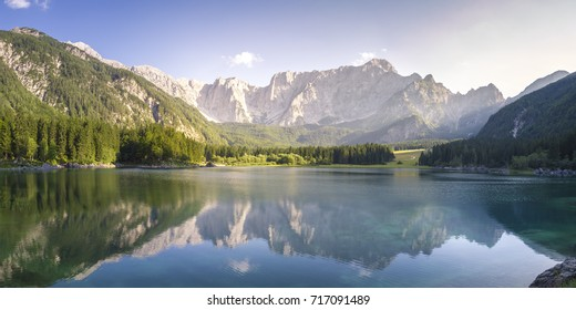 Superior Fusine Lake with Mount Mangart on the background. Fusine Lakes Natural Park, Tarvisio, Udine province, Friuli Venezia Giulia, Italy.