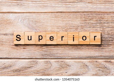 SUPERIOR word written on wood block. SUPERIOR text on wooden table for your desing, concept.