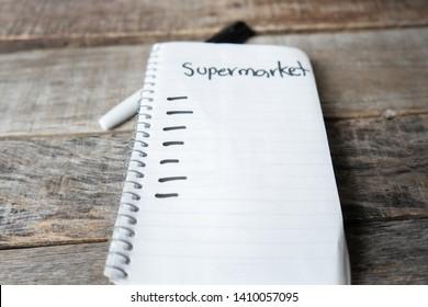 Supermaket list blank  written with black marker on white notebook