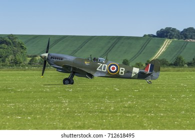 Supermarine Spitfire IX registration G-ASJV - MH434 ZD-B taxiing on the grass airfield on May 27th 2012 at Duxford, Cambridgeshire, UK