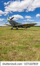 SUPERMARINE SPITFIRE MARK IXB, MH434, ENGLAND – AUGUST 11 2013, Supermarine Spitfire Mark IXb World War Two fighter plane, parked by the grass runway at White Waltham Airfield, Maidenhead, England