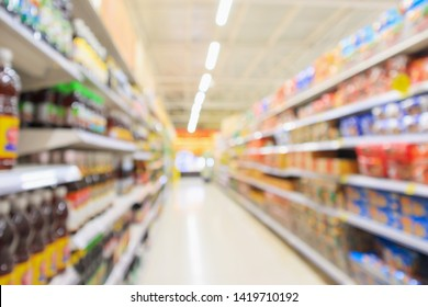 supermarket aisle with product shelves interior defocused blur background
