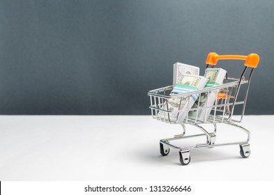 Supermarket cart with packs of dollars. The concept of microcredit and payday loans. Advertising financial services. Trap with high interest per annum, collectors. Illegal lending.