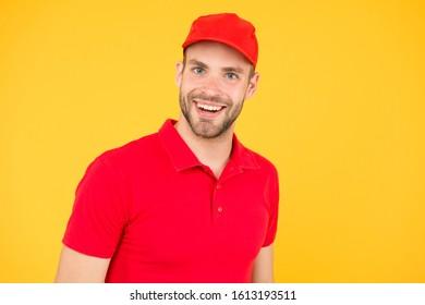 Supermarket cashier. Man delivery service wear red cap. Shop assistant. Food order delivery man. Cashier occupation. Hiring shop worker. Handsome guy cashier uniform. Restaurant cafe staff wanted.