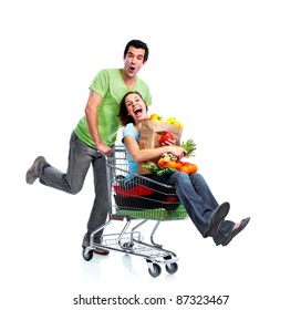 Supermarket.  Happy couple with a shopping cart. Isolated over white background.