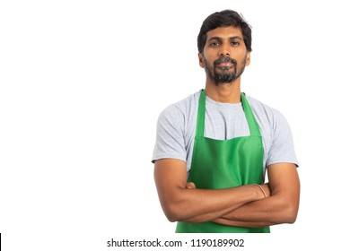 Supermarket or hypermarket indian employee standing with arms crossed isolated on white background with blank copy space