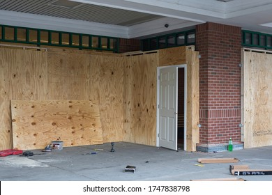 supermarket owners are using wood meant to board up shops as shields to prevent the damage caused by the violent protesters. impose curfew