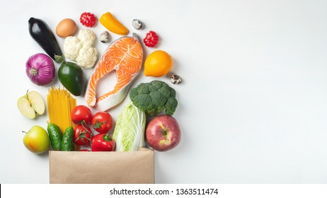 Supermarket. Paper bag full of healthy food. With copy space.