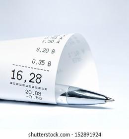 Supermarket receipt and ball pen