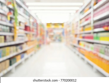 Supermarket or retail store blur background. That is a self-service shop offer grocery and variety of food, beverage and household product on shelf or rack. For product display, shopping background.
