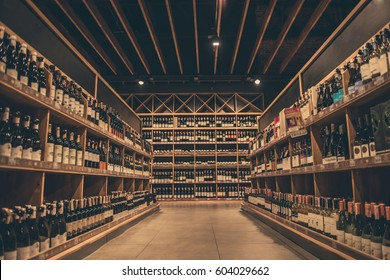 At the supermarket. Rows of wine waiting for customers