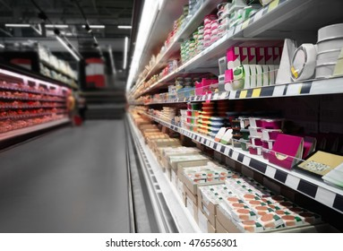 Supermarket shelves with dairy products