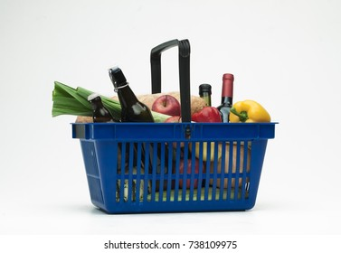 Supermarket shopping basket filled with groceries on white background - 1