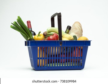 Supermarket shopping basket filled with groceries on white background 2