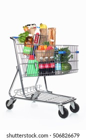Supermarket shopping cart full of everyday items.