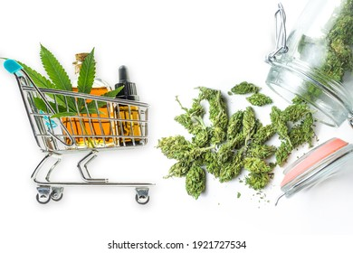 Supermarket trolley with CBD oils and Marihuana flower buds isolated on white