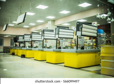 Supermarket yellow cashbox in the big shopping mall. Entrance of grocery store. retail company. Store without customers crowd cashier near cash desk. Store or market retail interior. Shopping concept