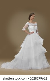 Supermodel in Wedding Bridal White Lace Dress, Fashion Make Up and hair style , full body fashion pose
