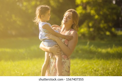 Supermoms raise super kids. Mother with daughter in nature.