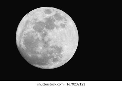 a supermoon with black isolated background