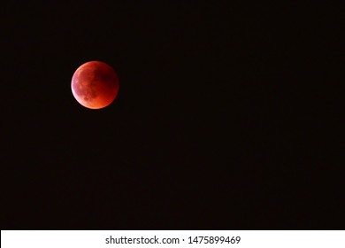 Supermoon or Blood moon in the black sky