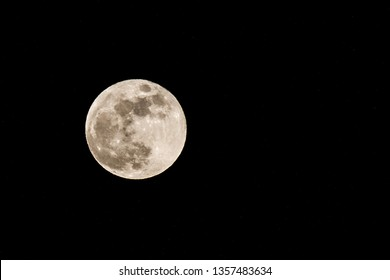 A supermoon displayed against a black background of the night sky