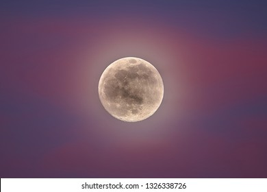 Supermoon. Full moon in pink clouds. Super moon 2 19 2019