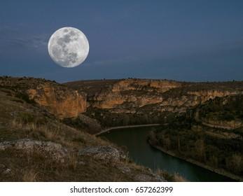 Supermoon landscape at night in Hoces del rio Duraton, Segovia, Spain