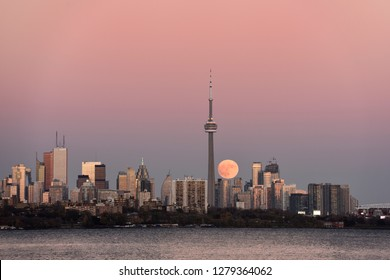 Supermoon of November 13 2016 rising over Toronto city skyline Toronto, Ontario, Canada - November 13, 2016