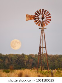 Supermoon Rising behind Windmill
