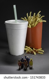 Supersize epidemic - people waiting for fast food soda and fries