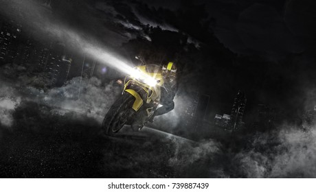 Supersport motorcycle rider driving at night. Modern skyscrapers on background. Smoke effect around. Speed, travel and freedom wallpaper photography.
